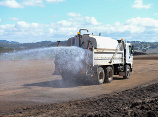 Water truck wetting road